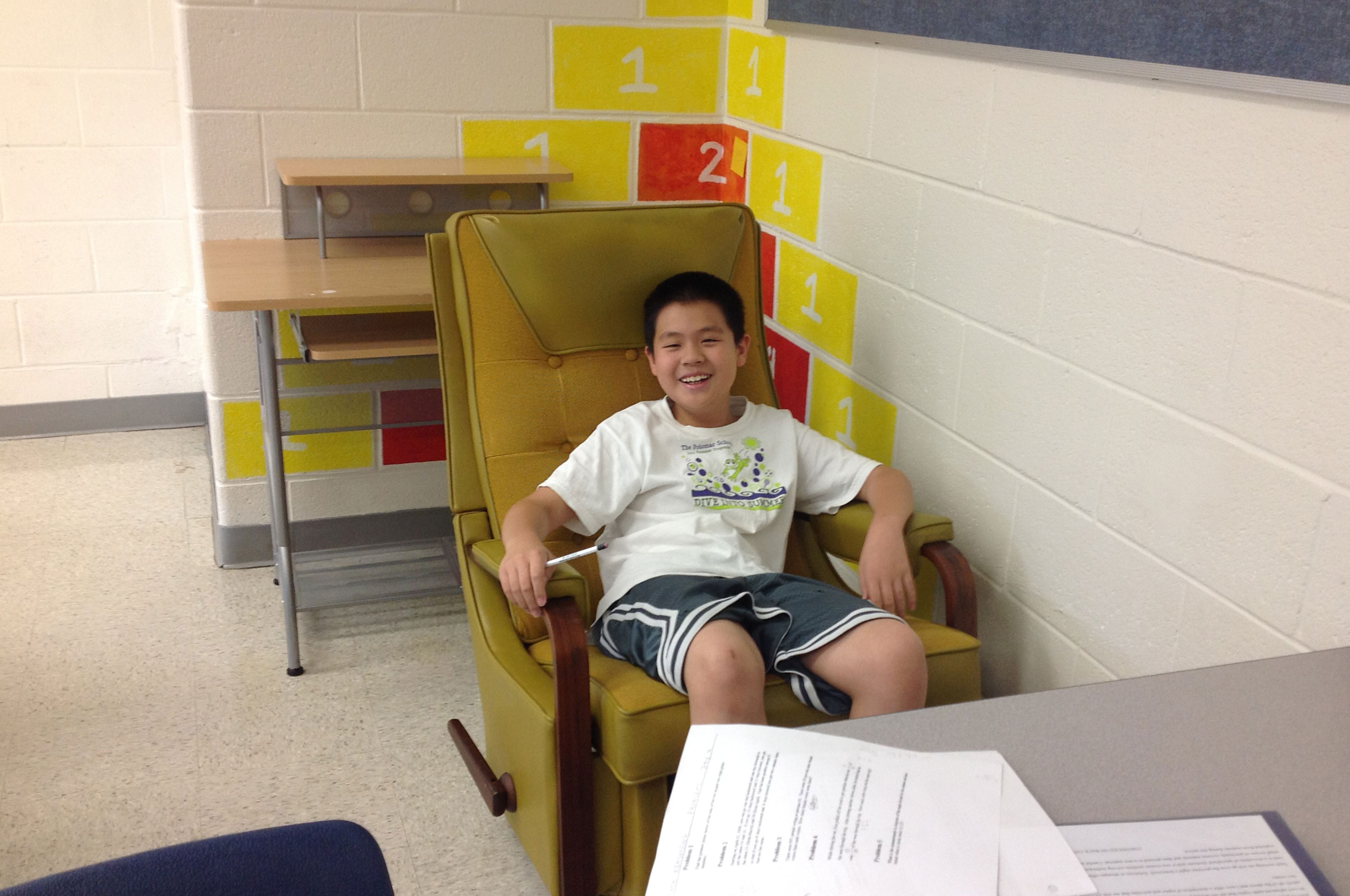 smiling student sitting on chair