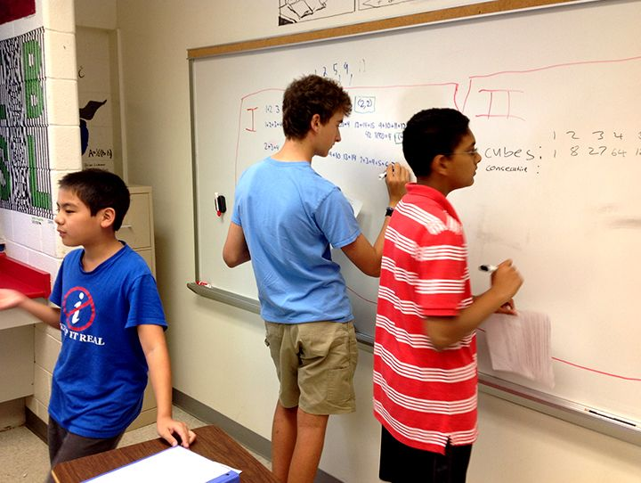 boys-solving-cubes-consecutive-problem.jpg