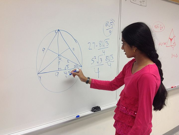 girl-solving-a-geometry-problem.jpg